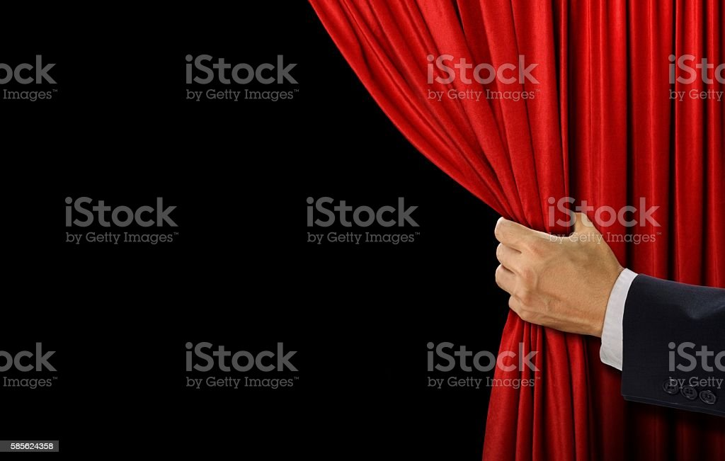 Hand open stage red curtain on black background stock photo