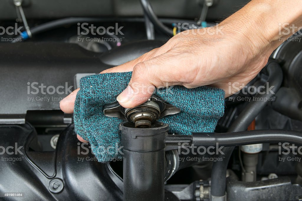 hand open valve metal cover on an radiator stock photo