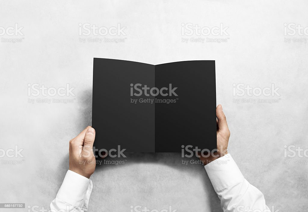 Hand opening blank black brochure booklet mockup. stock photo