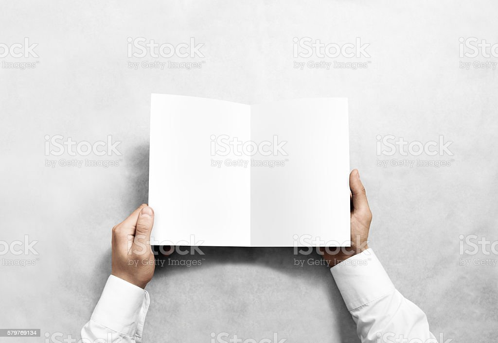 Hand opening blank white brochure booklet mockup. stock photo