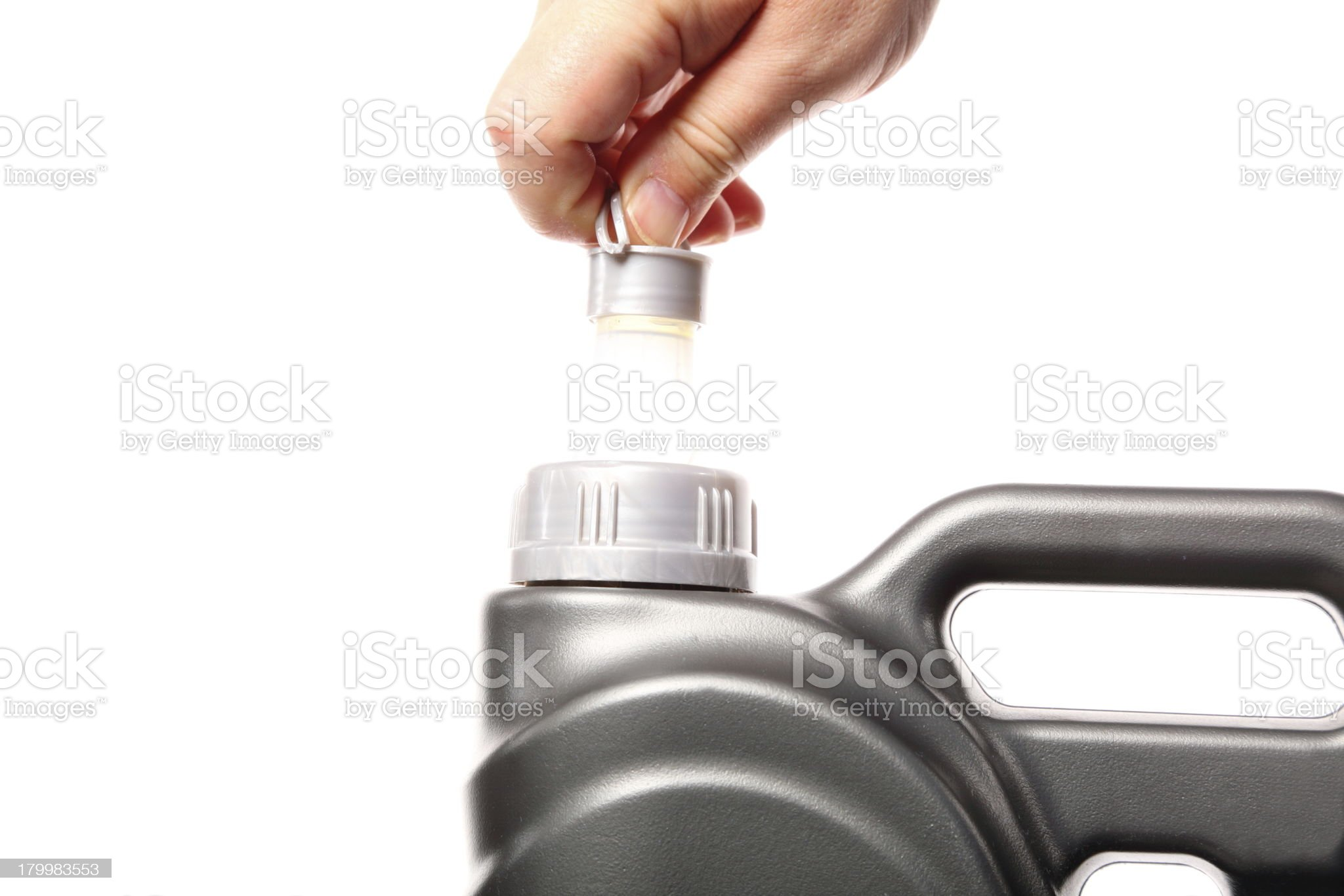 hand opening can with car engine oil isolated royalty-free stock photo