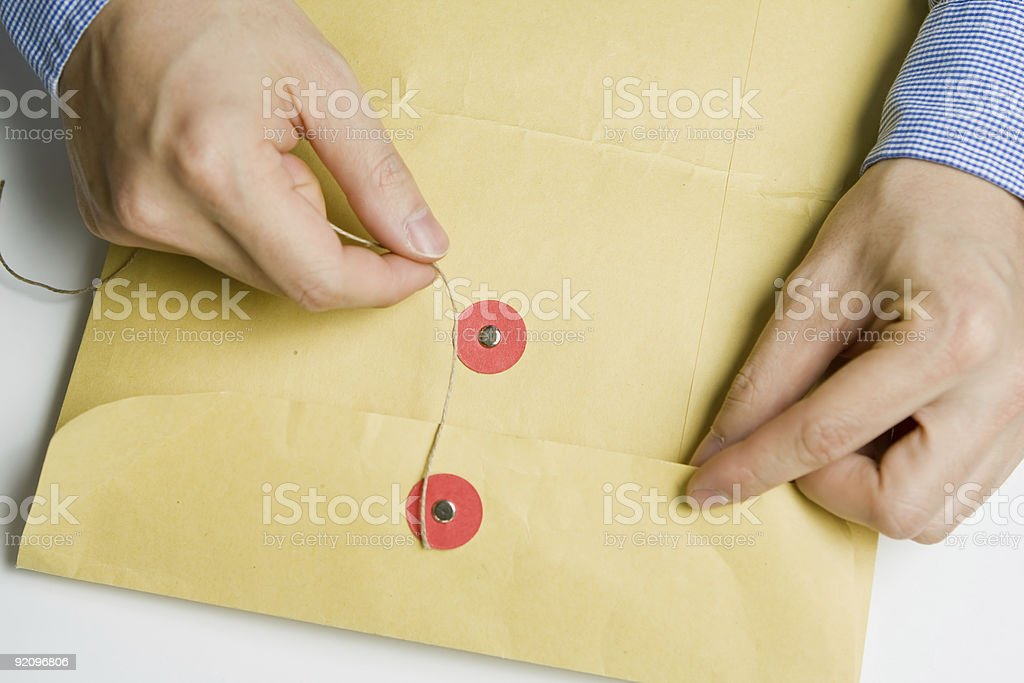 Hand opening confidential envelope royalty-free stock photo