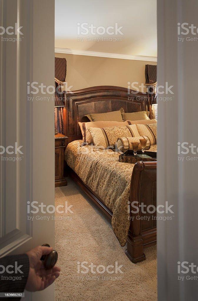 hand opening door into bedroom royalty-free stock photo