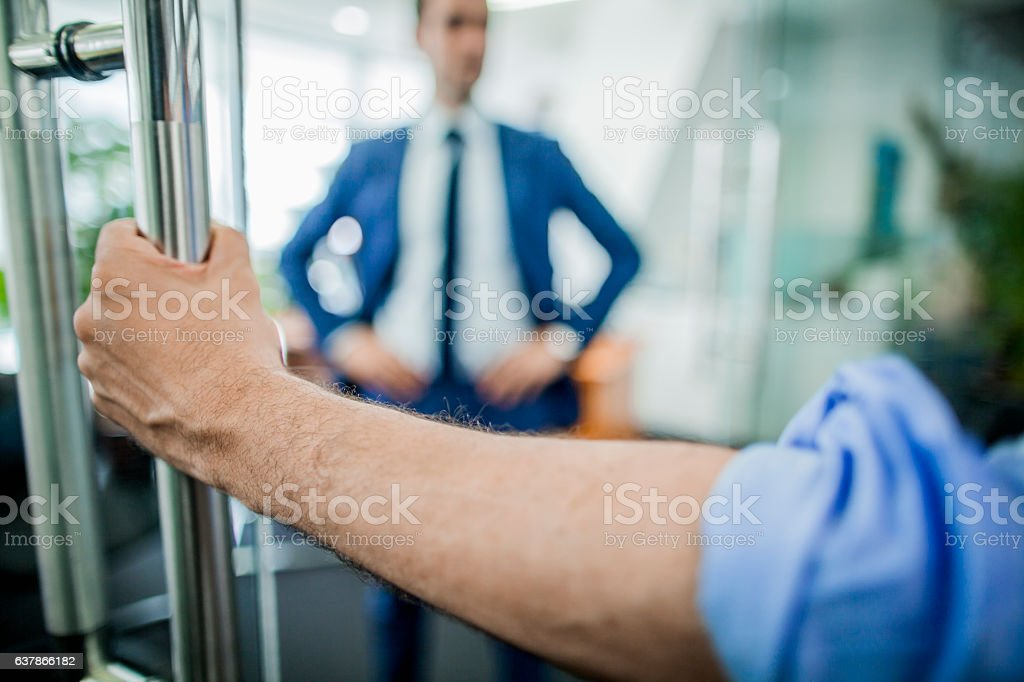 Hand opening door to businessman stock photo
