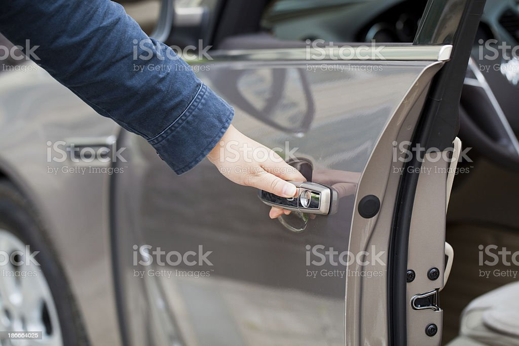 Hand opening the driver side door of vehicle stock photo