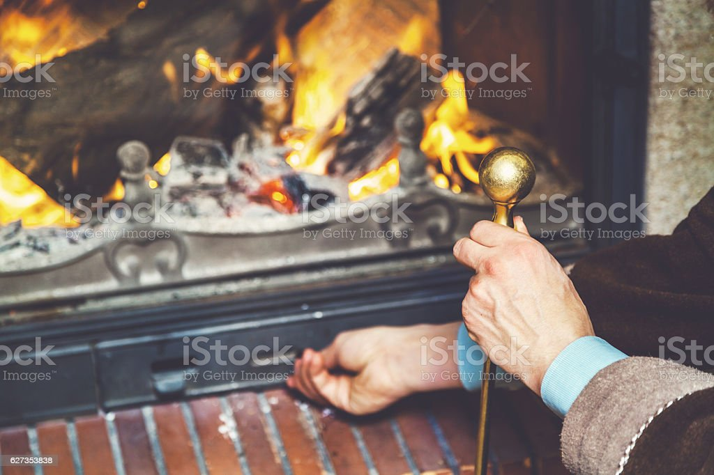 hand opens ash pan fire which burn firewood stock photo