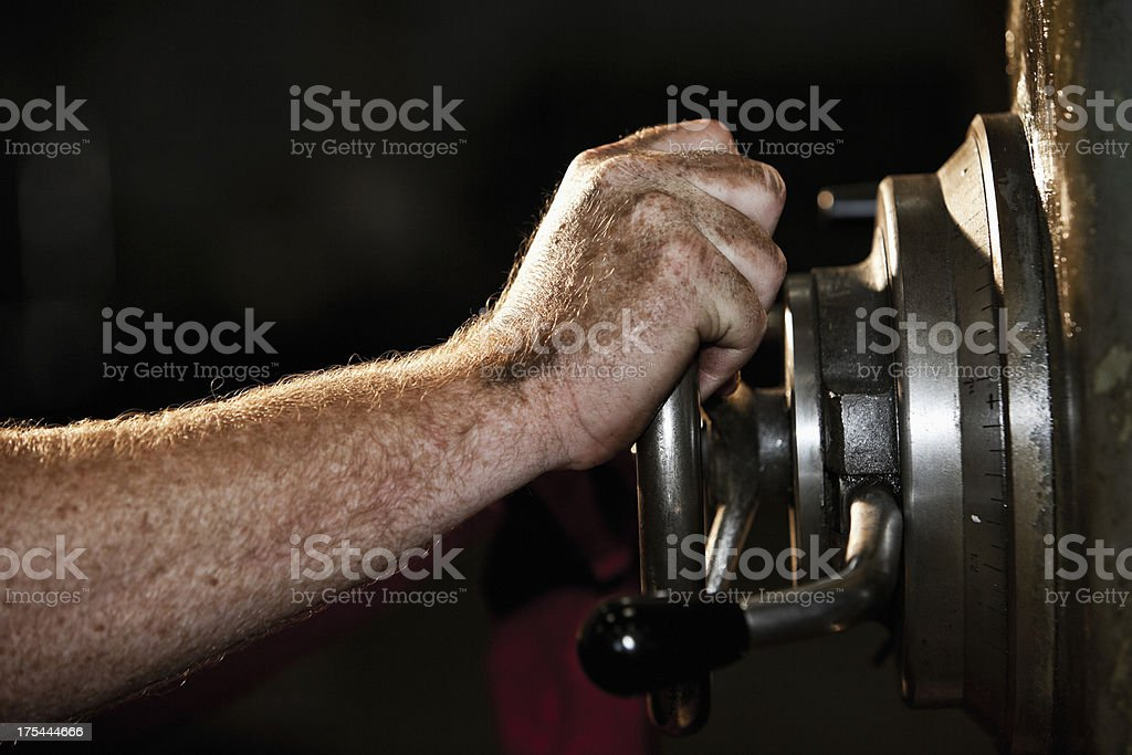 Hand operating drill press royalty-free stock photo