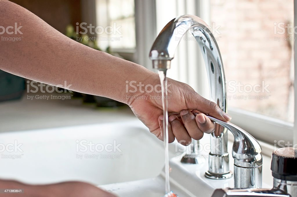Hand Operating Faucet royalty-free stock photo