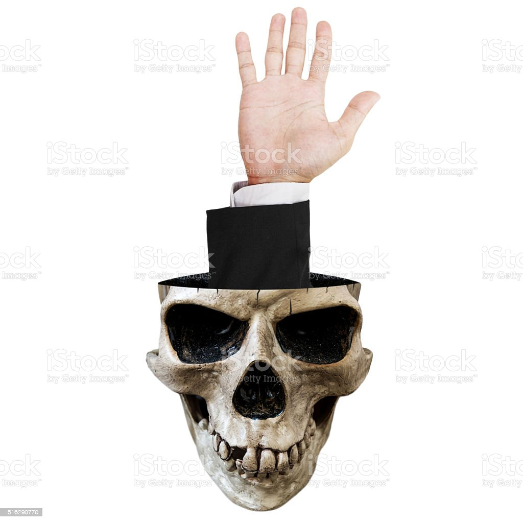 Hand out of skull, isolated on white background stock photo