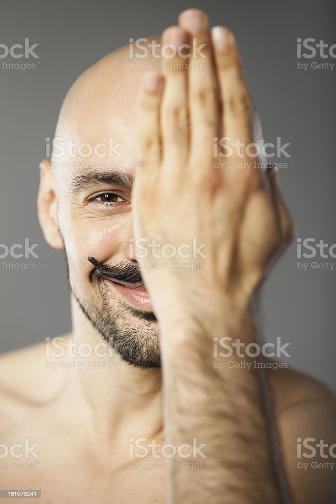 Hand over eye, smiling royalty-free stock photo