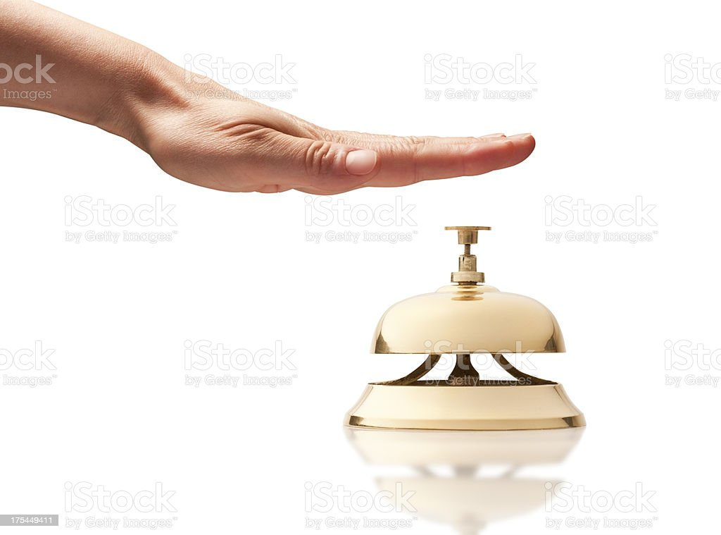 Hand over service bell on white background stock photo