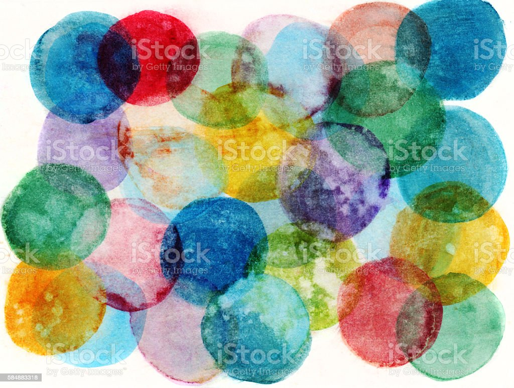 Hand painted circles of multiple colors on a white background stock photo