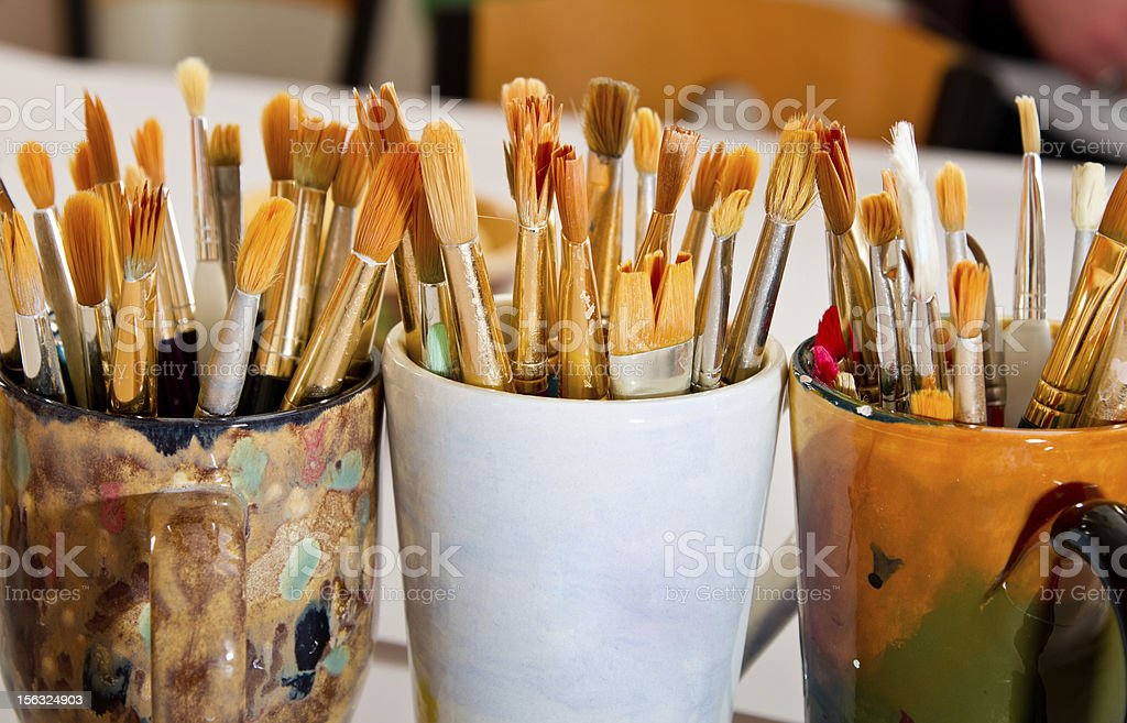 Hand painted Cups Full of Paintbrushes stock photo