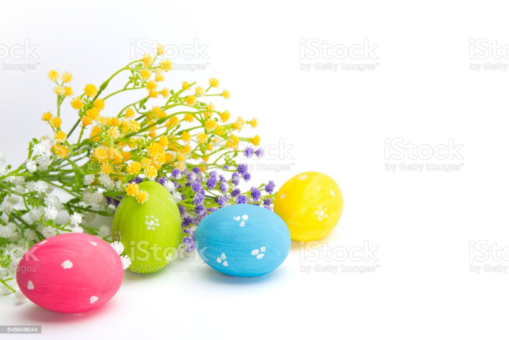Hand painted Easter eggs and flowers isolated on white. stock photo