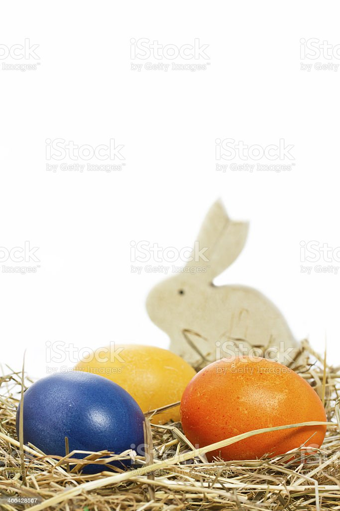 Hand painted easter eggs with bunny in a basket royalty-free stock photo