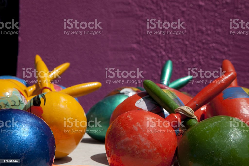 Hand Painted Maracas Against Purple Wall, Mexico, Colorful Toys royalty-free stock photo