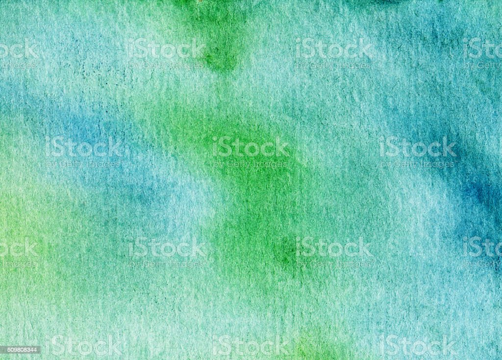 Hand painted mottled texture of green and blue hues stock photo
