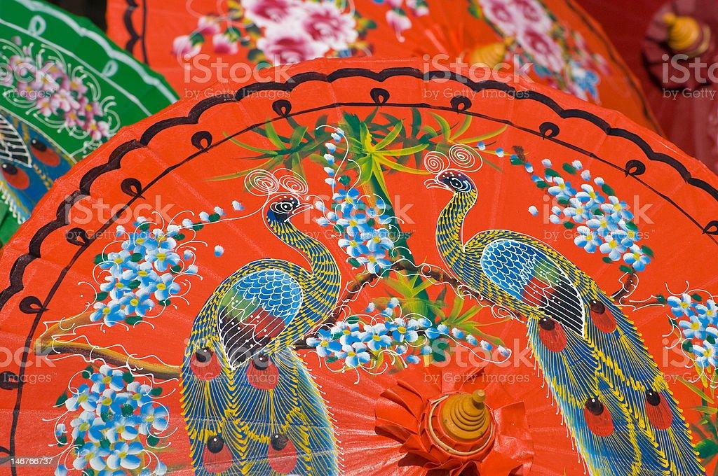 Hand painted orange umbrellas in Thailand stock photo