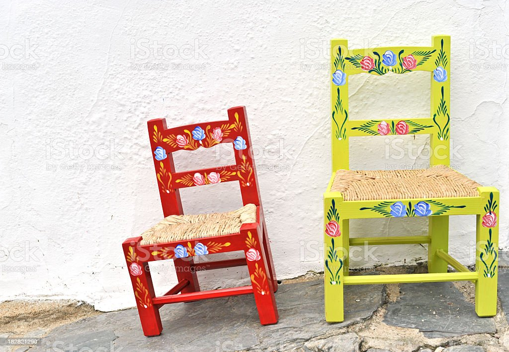 Hand painted rustic chairs in Portugal royalty-free stock photo