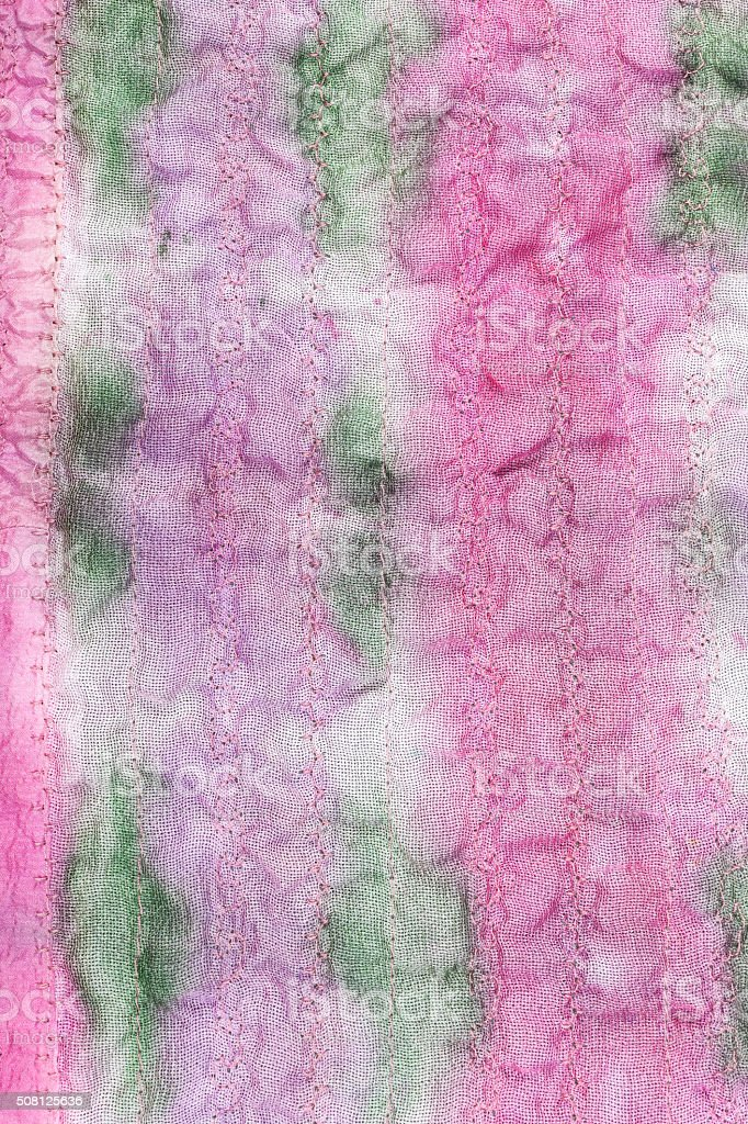 hand painted stitched pink and green silk fabric stock photo