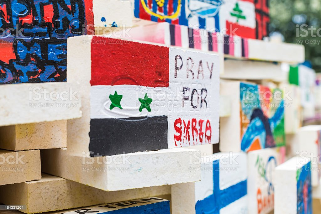 Hand Painted Tile - Pray for Syria stock photo