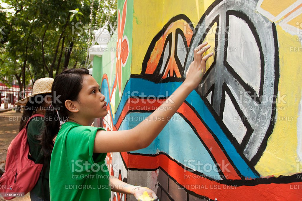 Hand painting for peace in a wall stock photo