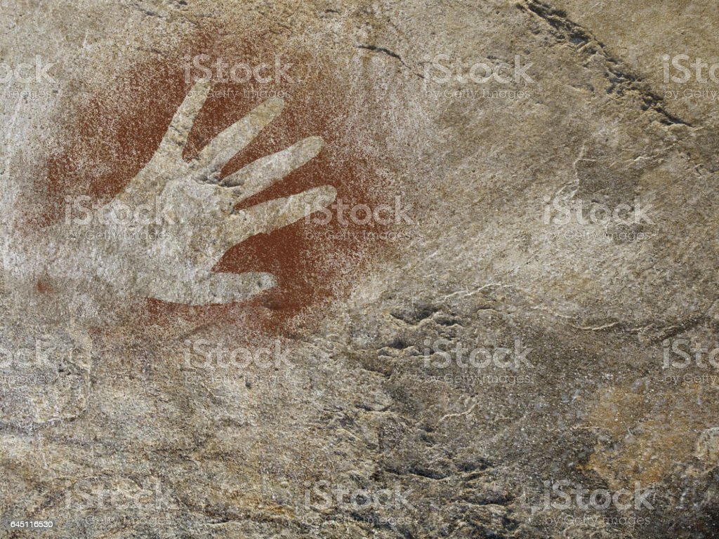 Hand painting stencil in the style of prehistoric cave art stock photo
