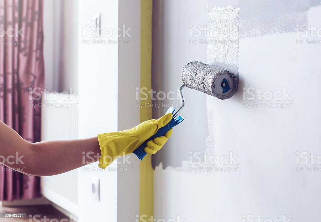 Hand painting wall in apartment stock photo
