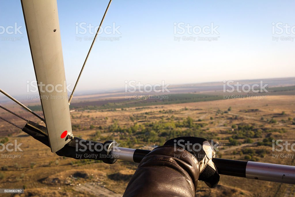 Hand paraglider pilot holding the bar stock photo