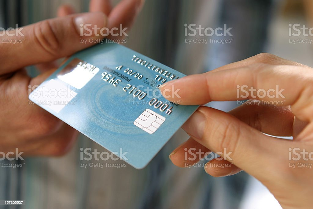 Hand passing a payment card (N.B. Mocked Up Details*) stock photo