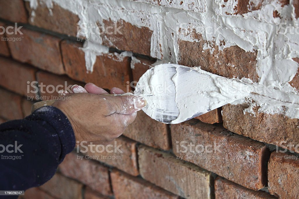 hand pastering cement mortal royalty-free stock photo