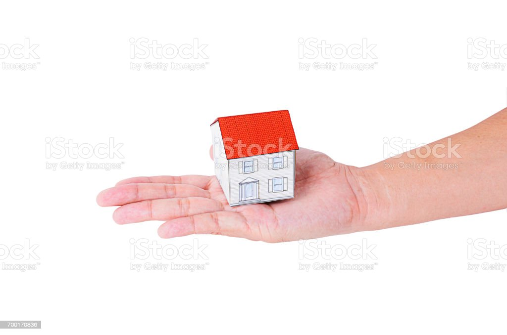 Hand people holding paper house model Isolated on white backgrounds stock photo