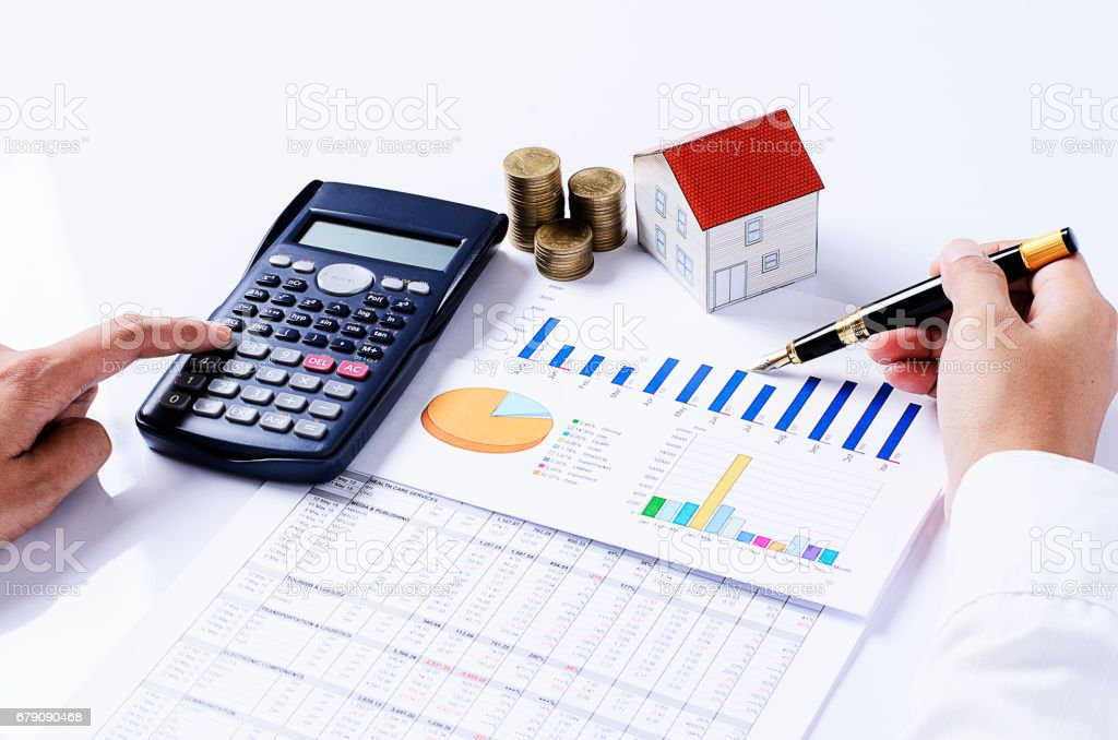 Hand people pointing calculator and fountain pen on business chart with coins stack and house paper for loans concept stock photo