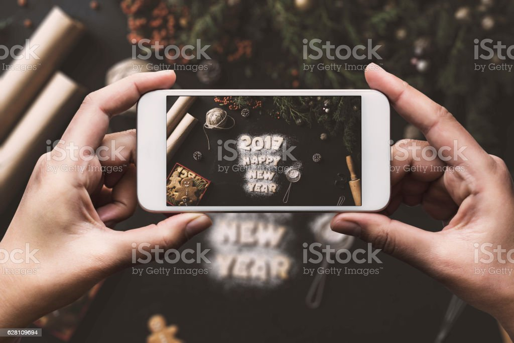 Hand photographing, Happy New year 2017 concept table top stock photo