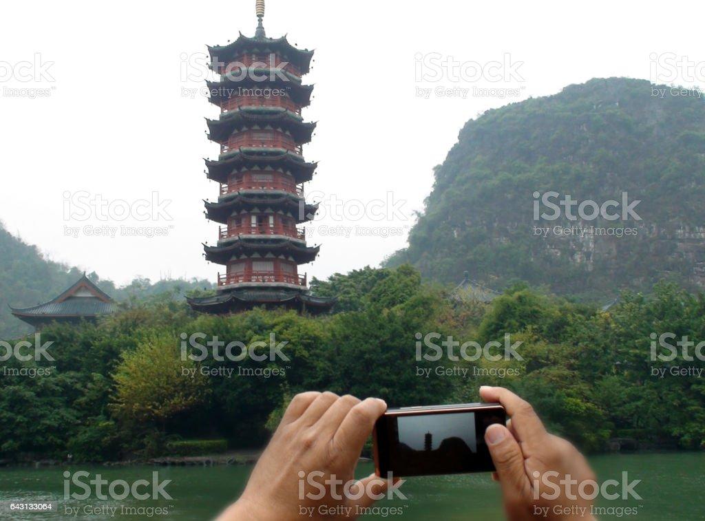 Hand Photographing Mulong Lake Pagoda In Guilin China stock photo