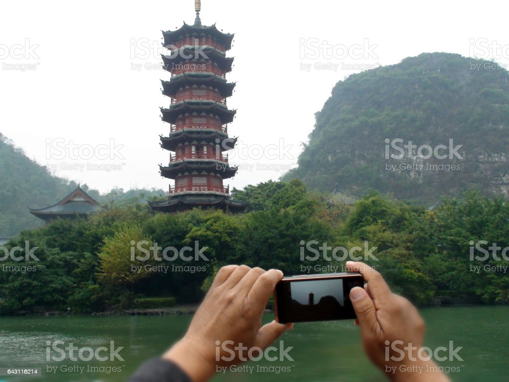 Hand Photographing Mulong Lake Park Pagoda In Guilin China Asia stock photo