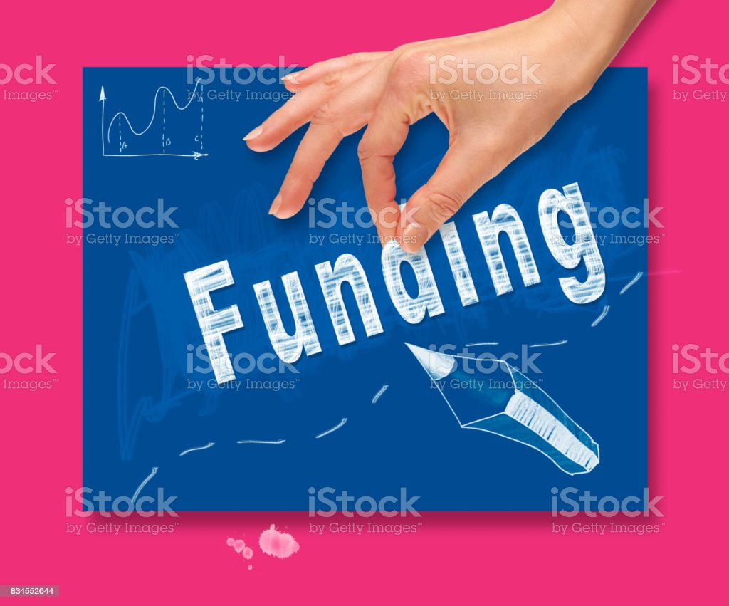 A hand picking up a Funding concept on a colorful drawing board stock photo