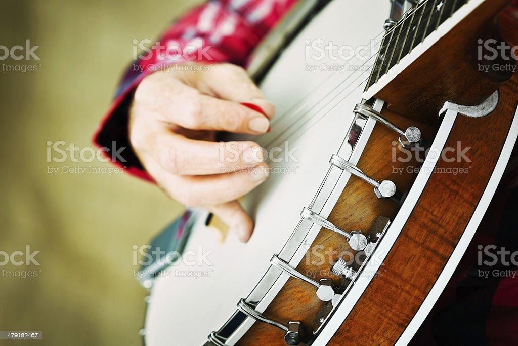 Hand playing banjo royalty-free stock photo