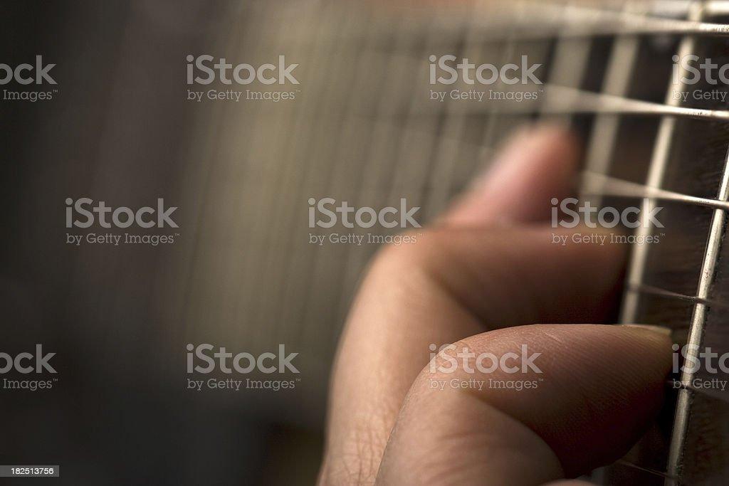 hand playing guitar stock photo