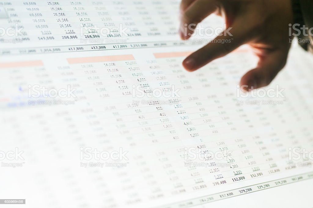 hand point on data report show on screen stock photo