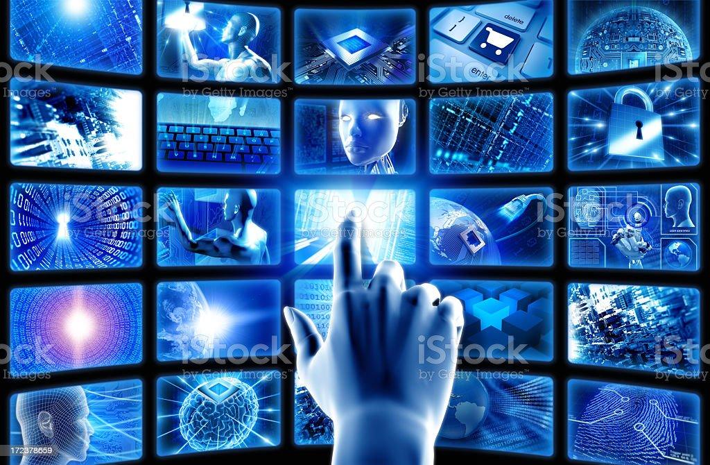 Hand pointing at hi-tech screens stock photo