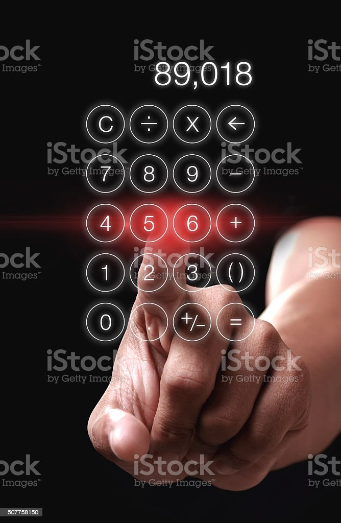 Hand pointing calculator app on black background stock photo