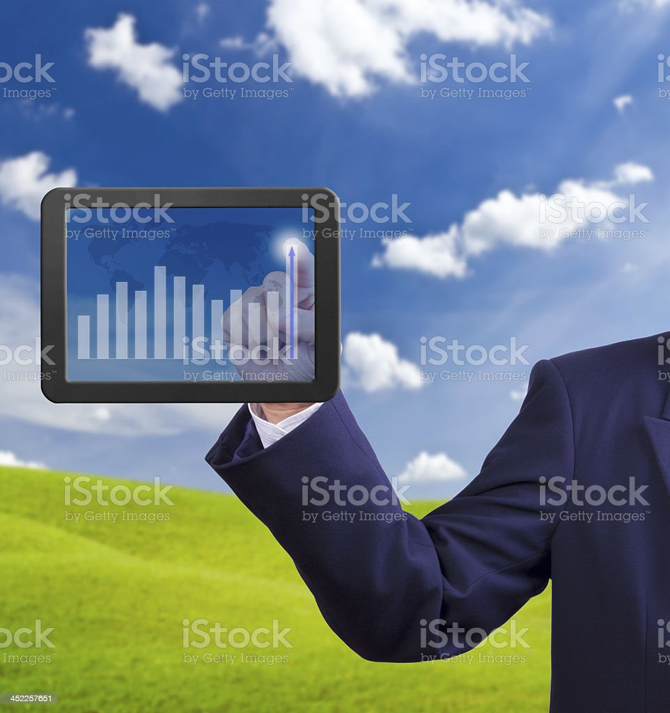 hand pointing higher graph on tablet PC royalty-free stock photo
