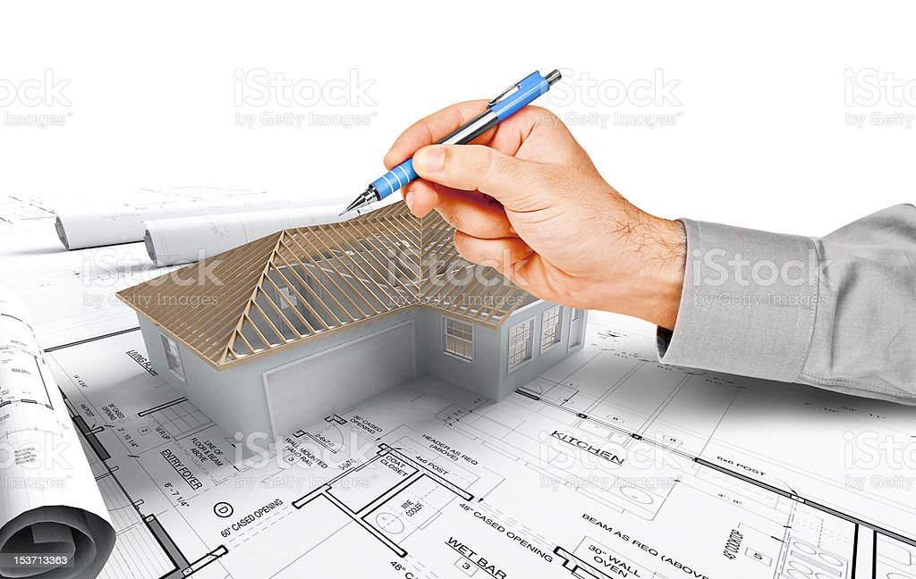 hand pointing on a house model royalty-free stock photo