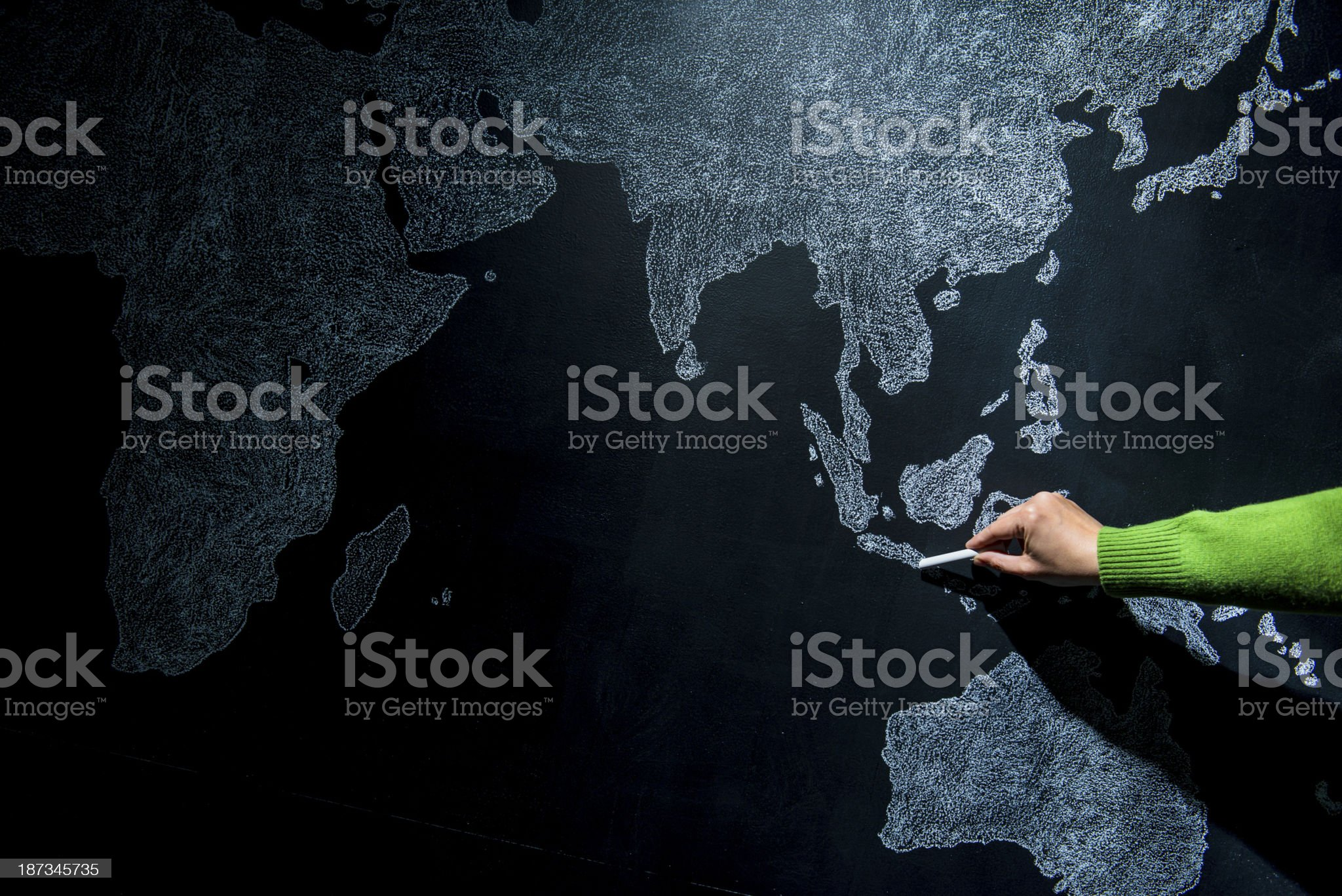 Hand pointing to Bali royalty-free stock photo