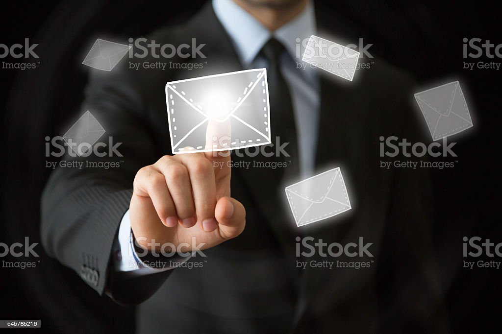 Hand pointing to mail symbol stock photo
