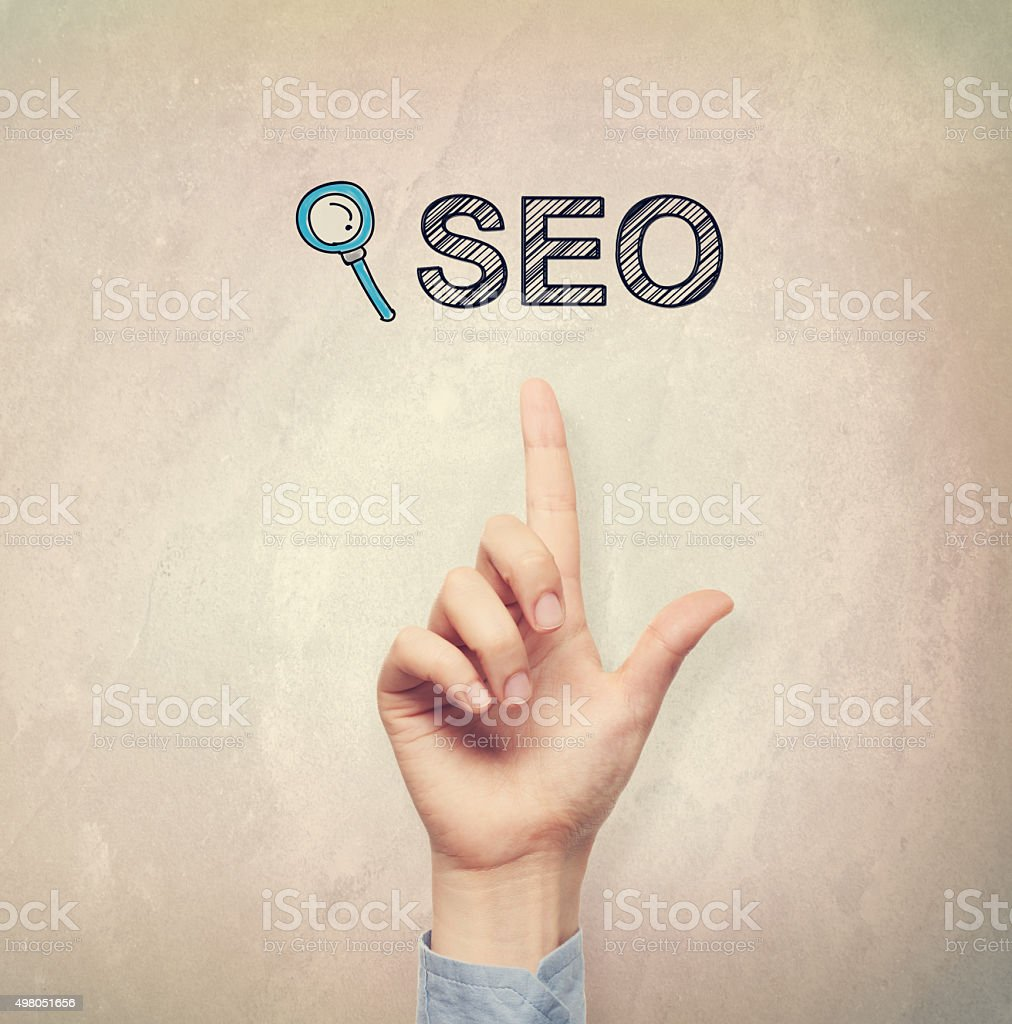 Hand pointing to SEO concept stock photo