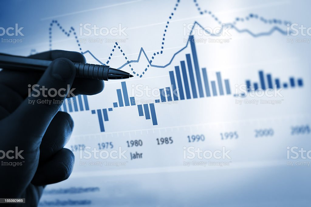 Hand pointing with pen on a computer chart / document stock photo