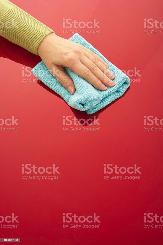 Hand polishing red shiny surface royalty-free stock photo