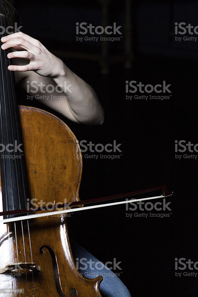 Hand position of a Woman playing cello on black background royalty-free stock photo